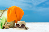 Summer beach bag with starfish,towel,sung lasses and flip flops poster
