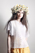 Summer fashion young woman in white wreath of flowers