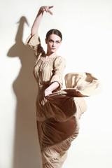 Woman dancing flamenco dancer in long flying dress