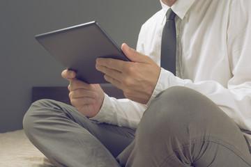Businessman holding digital tablet computer