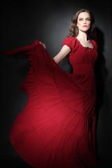 Elegant woman in red dress Fashion model