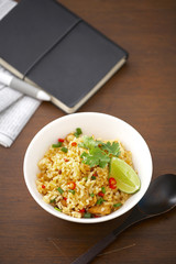 thai spicy fish and rice fried in white dish