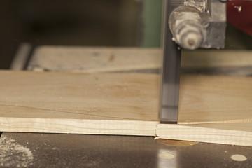 Bandsaw cutting wood plank