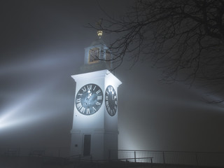 Old tower clock in Petrovaradin, Serbia on misty night