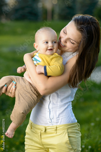 Happy mother holding a young son
