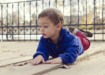 Child laying on ground outside