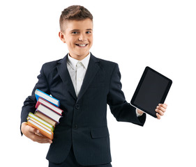 schoolboy holding a tablet and books
