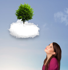 Young girl pointing at a green tree on top of a white cloud
