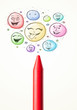 Smiley faces coming out of crayon
