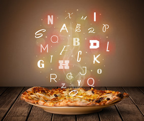 Fresh italian pizza with colorful letters on wood