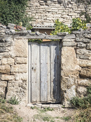 an old wooden door on a country house