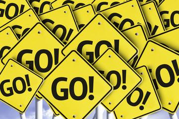 Go! written on multiple road sign