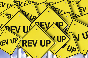 Rev Up written on multiple road sign