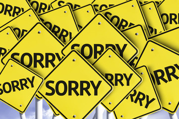 Sorry written on multiple road sign
