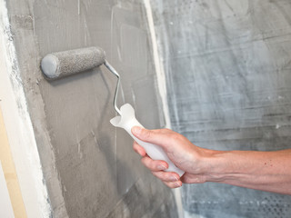Painting a wall with a roller
