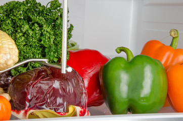 Different vegetables inside a refrigerator