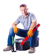 man sitting on a box with tools