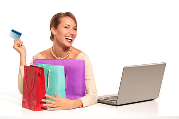 Young Woman Sitting at the desk  shopping Online