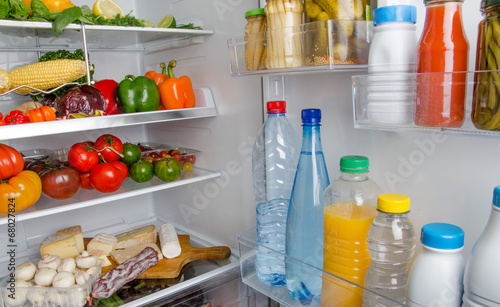 Plexiglas Koken Different food products inside a refrigerator