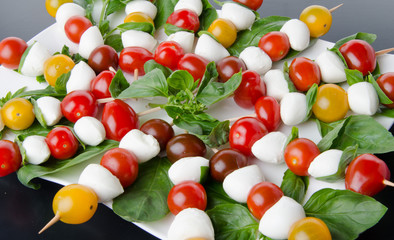 Cherry tomatoes and mozzarella on skewers
