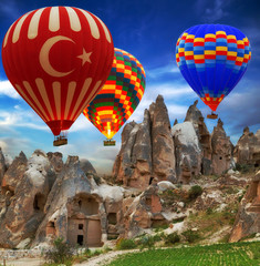 Hot air balloon flying mountain