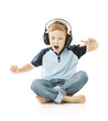 Boy Child in headphones listening to music and singing on white