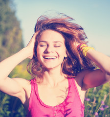 portrait of young beautiful happy woman with flying hair