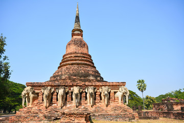Ancient pagoda with elephant sculptures in Sukhothai Historical