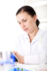 Female Scientist Using Tablet  In Laboratory