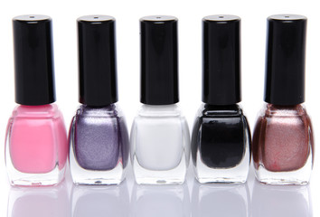 Five nail polish bottles