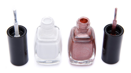 Two open nail polish bottles