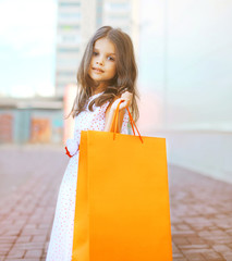 Beautiful fashion little girl with shopping bag