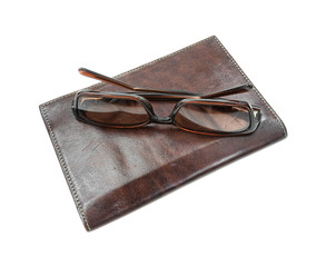 Sunglasses atop billfold