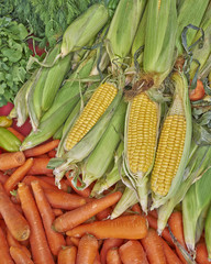 organic corn cobs and carrots at the local market