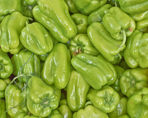 organic green bell peppers, natural background