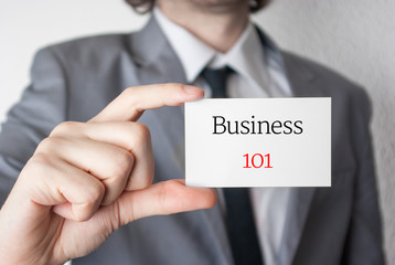 Business 101. Businessman showing business card