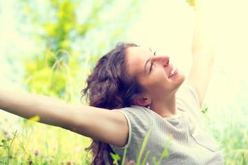 Beautiful Young Woman Outdoors. Enjoying Nature