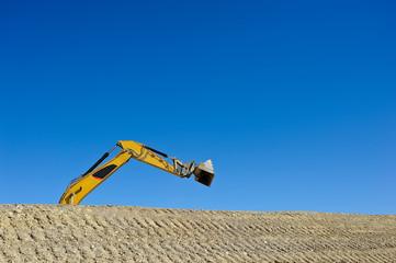 Arm eines Bagger isoliert auf Baustelle