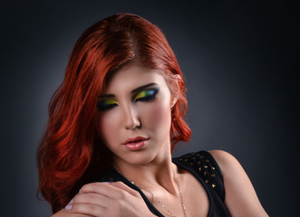 Close up of a woman with creative colorful make up