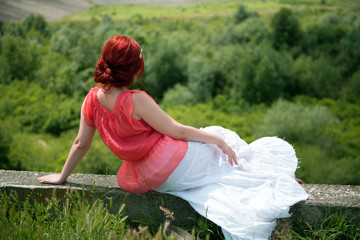 young woman admiring the nature in a summer day