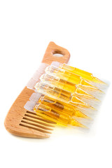 Hair oil and wooden comb.