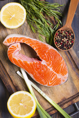 Salmon, lemon and spices closeup.