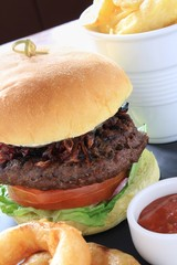 gourmet beefburger with goats cheese isolated