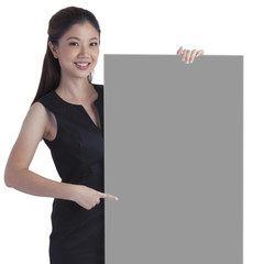 Businesswoman holding commercial sign