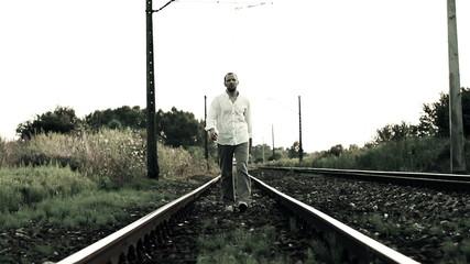 Man walking on railroad tracks, super slow motion, 240fps