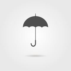 black icon of umbrella with shadow