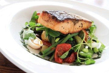pan seared salmon steak with bean salad meal