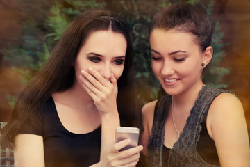 Young Women Surprised by Text Message