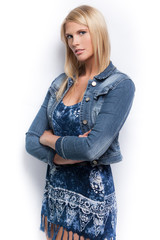 Young beautiful blond girl wearing blue jacket.