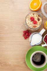 Healty breakfast with muesli, berries, orange juice, coffee and